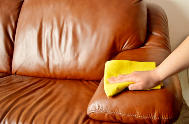 Cleaning a brown leather sofa