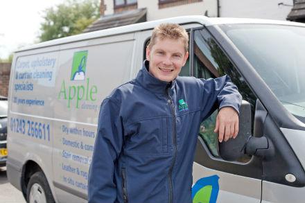 Apple Clean smiling man in front of van