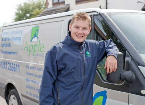 Apple Clean Carpet cleaning engineer next to van