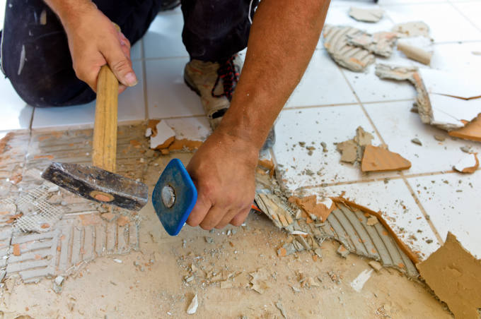 broken tiles in the renovation of a bathroom. remodeling and renovation in the living area. tiler at work