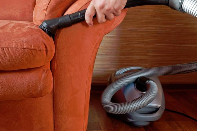 Vacuuming a sofa