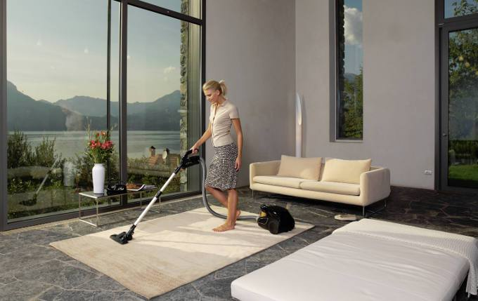Woman vacuuming a house